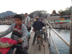 Motorbikes on a bamboo bridge, Vang Vieng, Laos, 2017